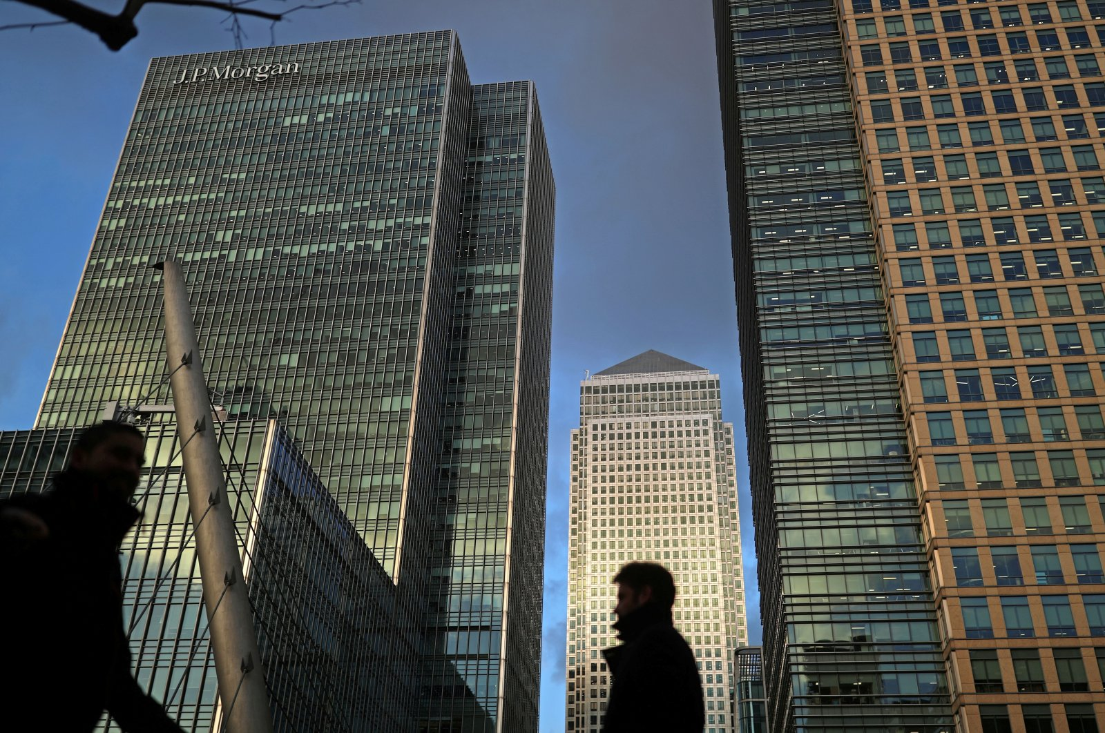 People walk through the Canary Wharf financial district of London, Britain, Dec. 7, 2018. (Reuters Photo)