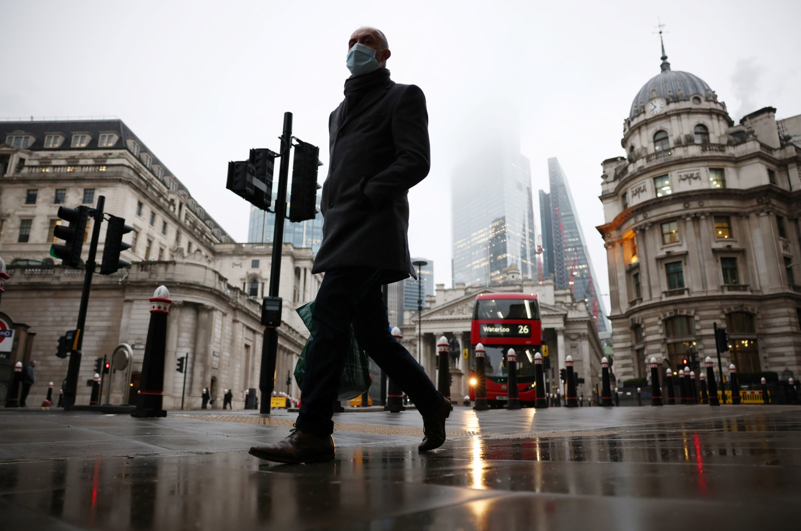 A man walks through the City of London financial district amid the COVID-19 outbreak, in London, Britain, March 4, 2021. (Reuters Photo)