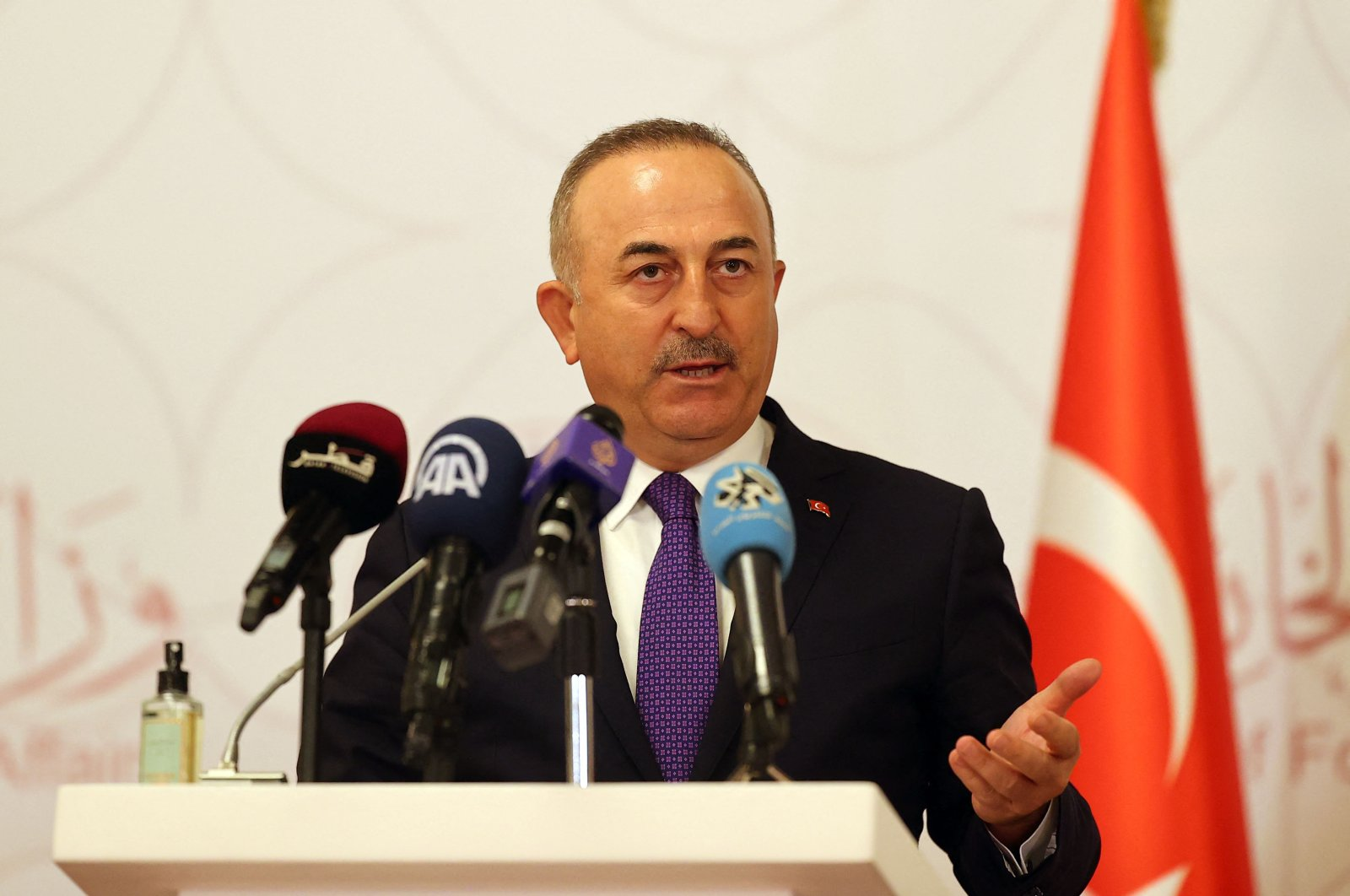 Turkish Foreign Minister Mevlüt Çavuşoğlu attends a joint press conference following a tripartite meeting with his Russian and Qatari counterparts, in Doha, Qatar, March 11, 2021. (Photo by KARIM JAAFAR / AFP)