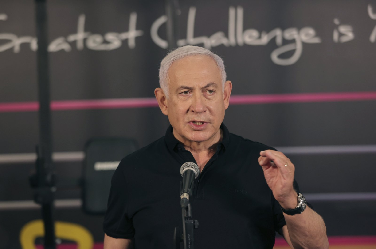 Israeli Prime Minister Benjamin Netanyahu talks to the media during a visit to the Fitness gym ahead of the re-opening of the branch in Petah Tikva, Israel, Feb. 20, 2021. (AP Photo)