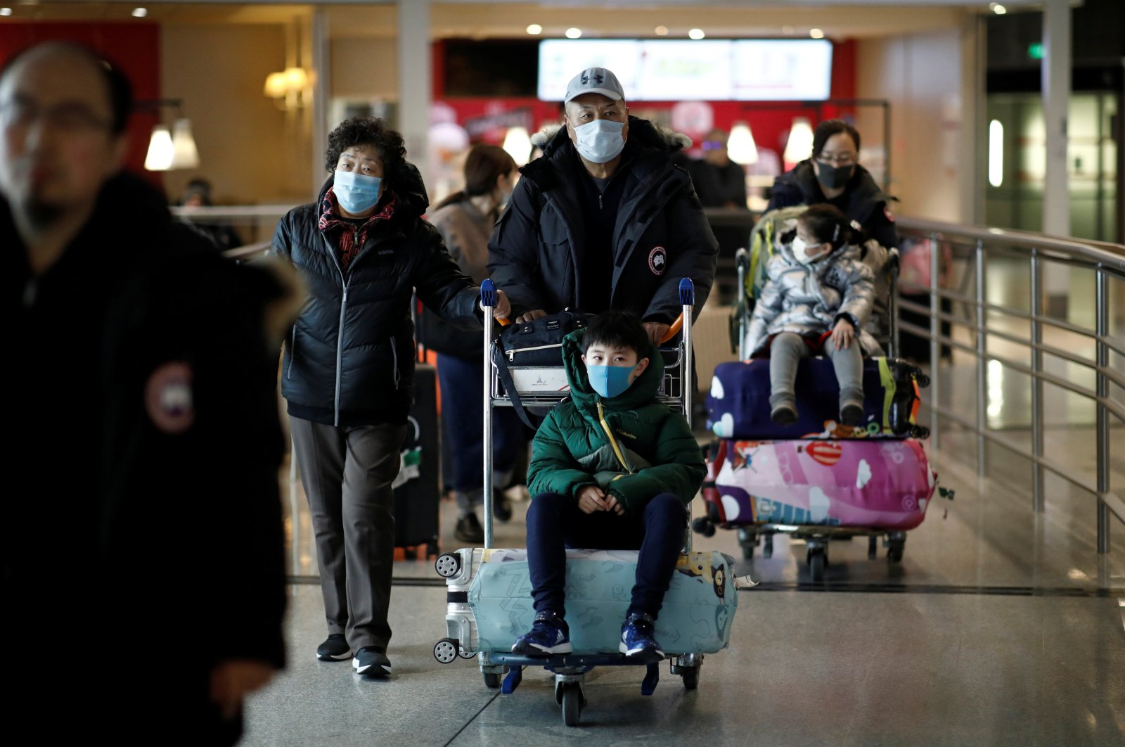 Tourists from an Air China flight from Beijing wear protective masks as they arrive at Charles de Gaulle airport in Paris, France, Jan. 26, 2020. (Reuters Photo)