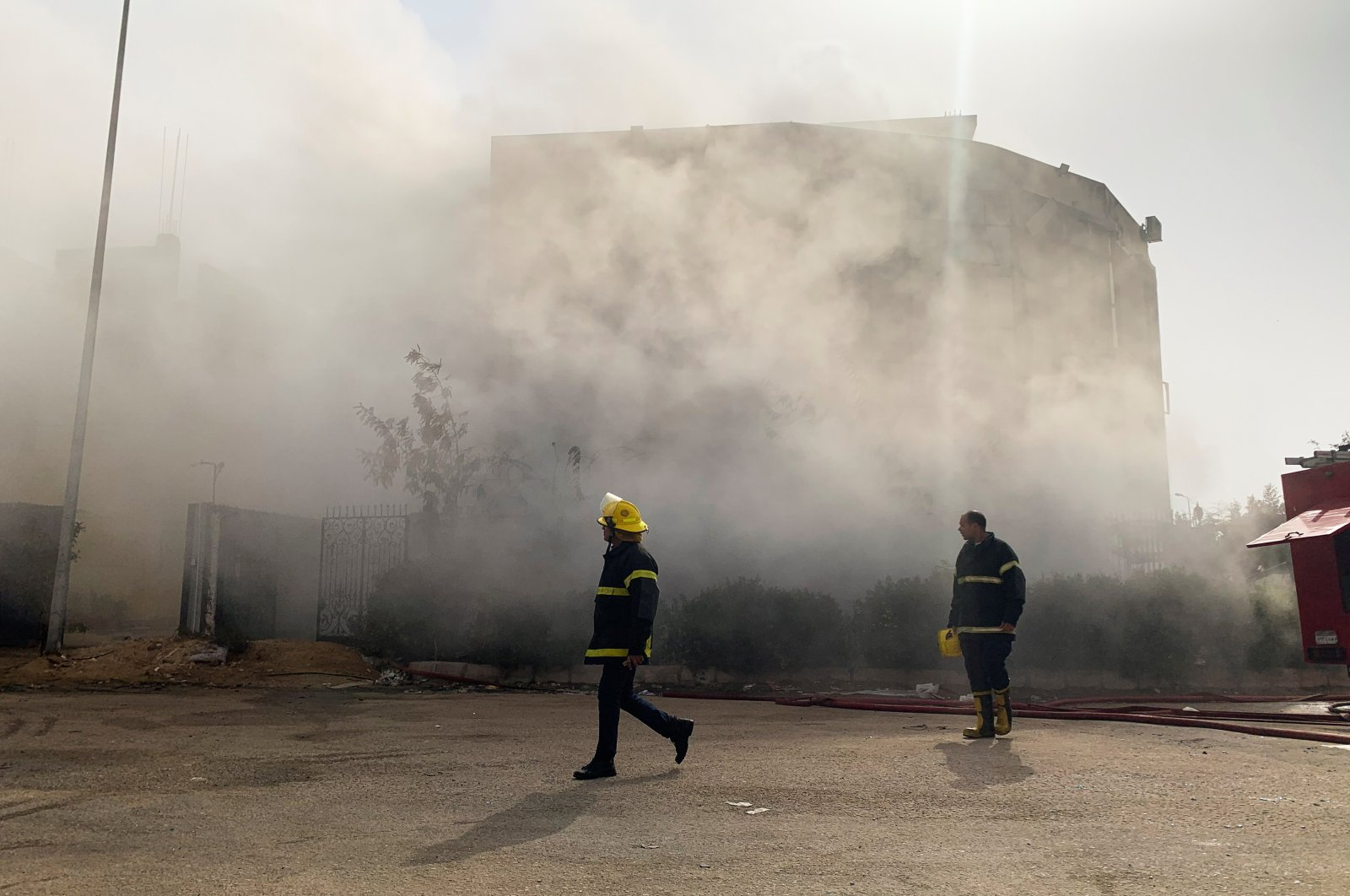 Firefighters are seen at the scene after a fire broke out in a garment factory north of Cairo, Egypt, March 11, 2021. (Reuters Photo)