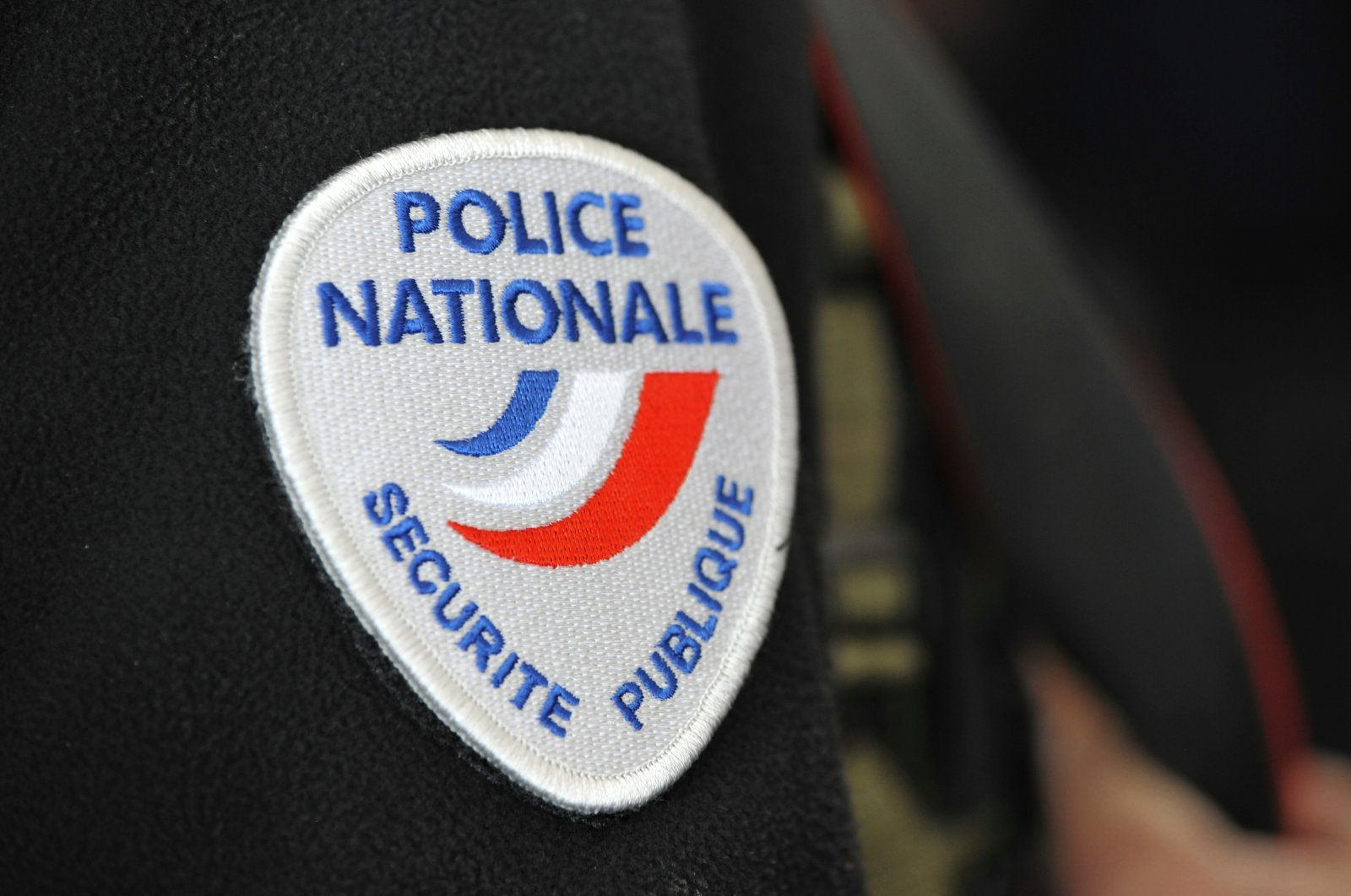 The French National Police symbol sewn onto the sleeve of a police officer is seen during a control operation in France's Marseille on Jan. 19, 2021 (Shutterstock Photo)