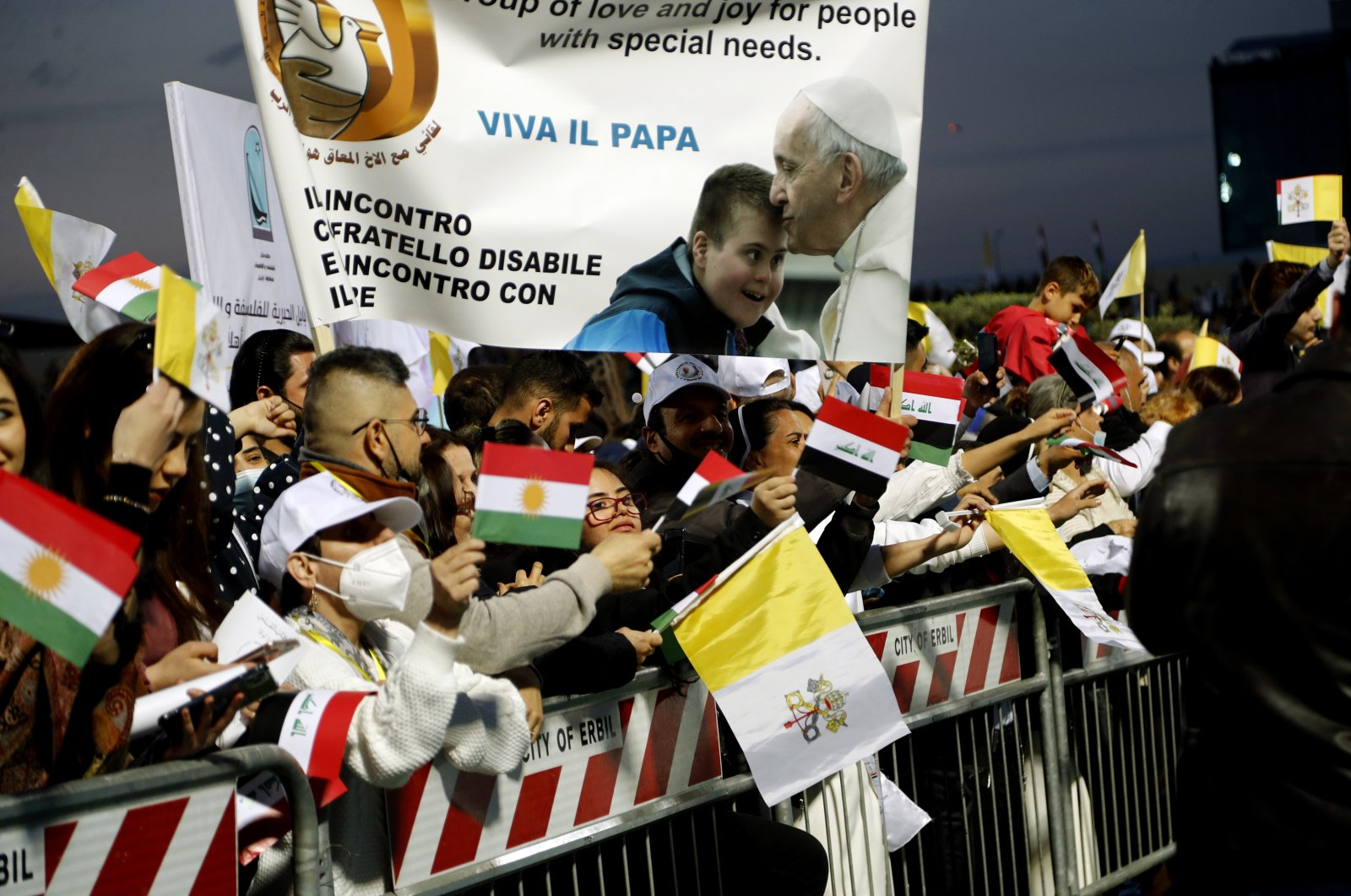 Iraqi Christians say goodbye to Pope Francis after an open air Mass at a stadium in Irbil, Iraq, Sunday, March 7, 2021. (AP File Photo)