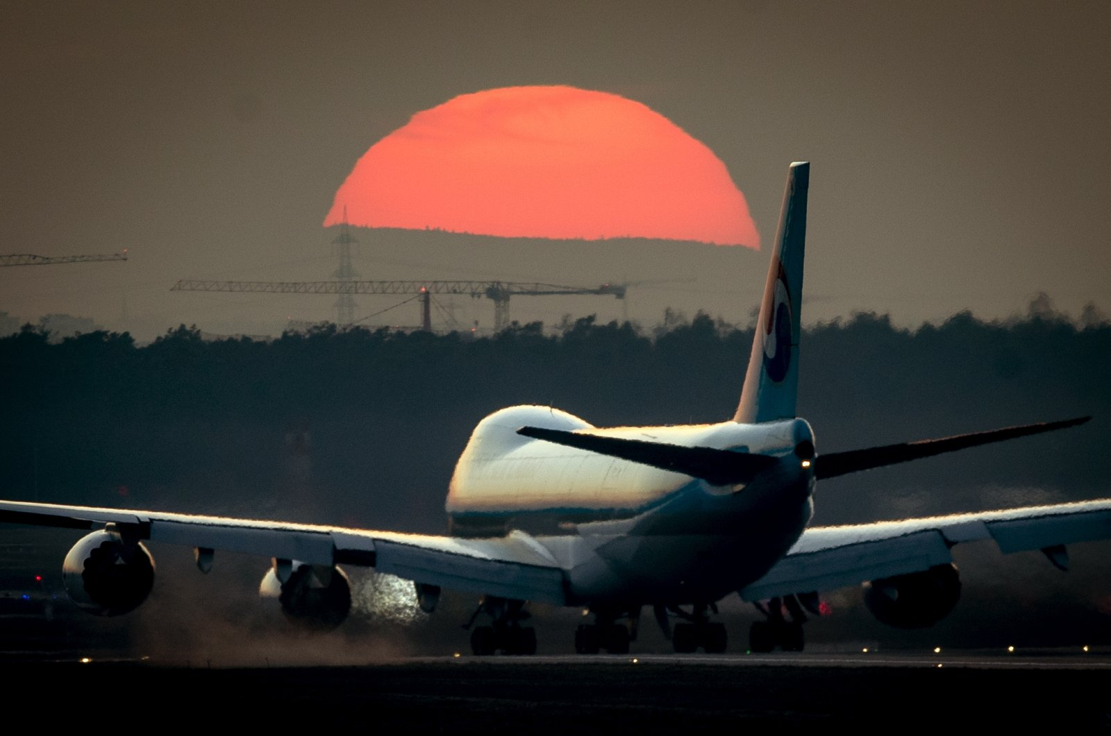 A Boeing 747 aircraft starts as the sun sets at the international airport in Frankfurt, Germany, March 2, 2021. (AP Photo)