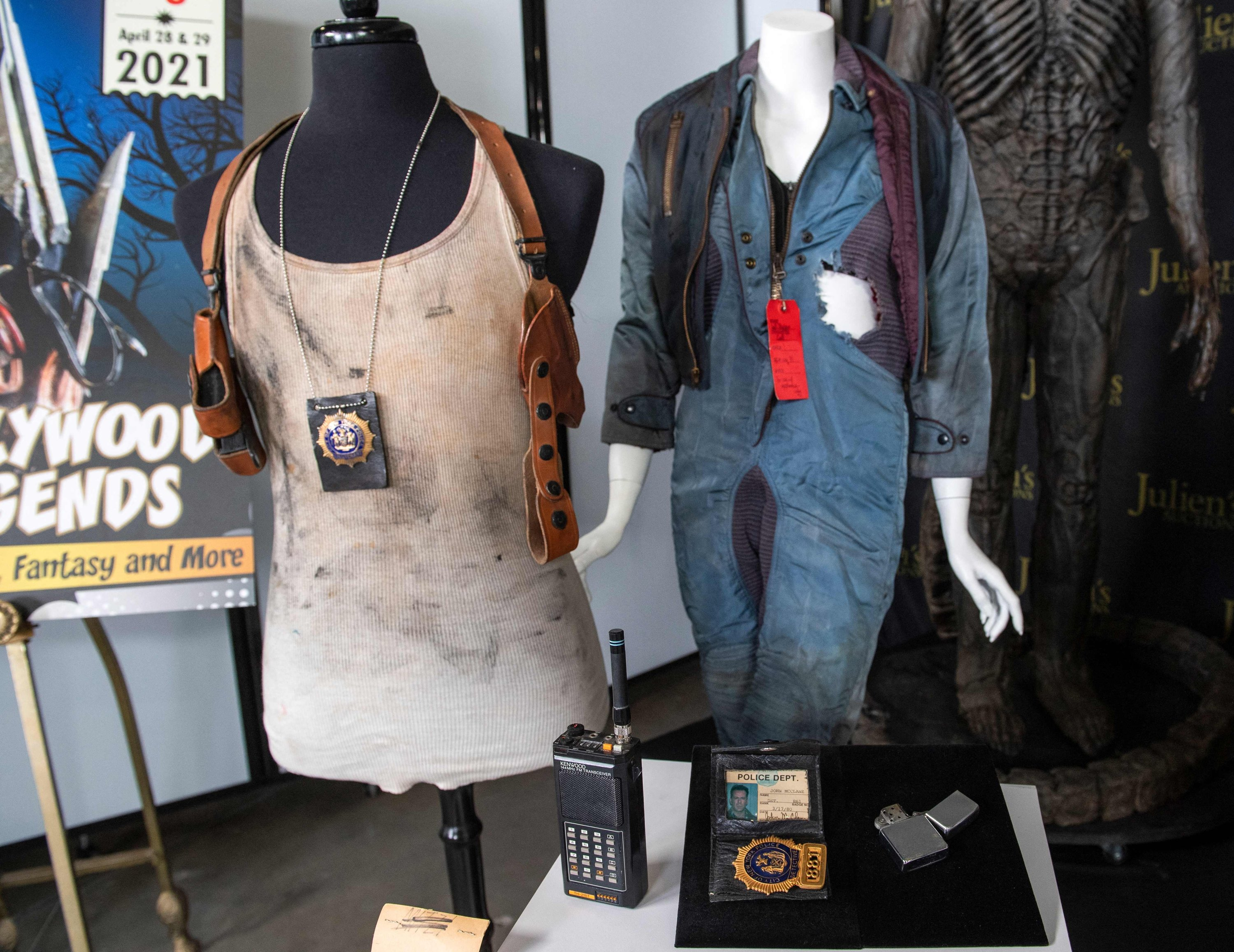 Props and costumes from various films including a studio distressed tank top with dual leather holster rig from 'Die Hard With A Vengeance' (L), are seen at the Julien's Auctions in Beverly Hills, California, March 10, 2021. (AFP Photo)