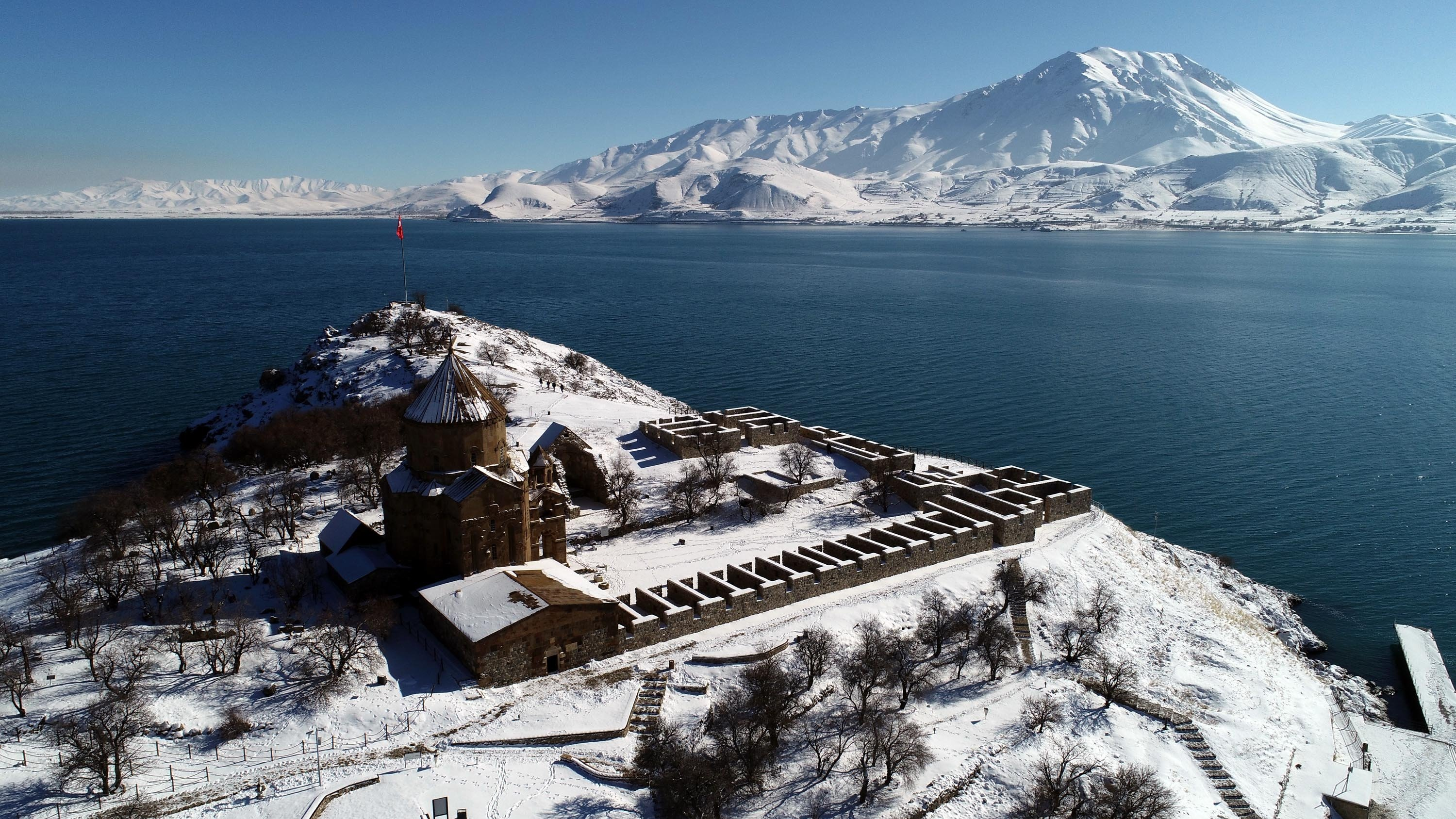 An aerial view of the Akdamar Church located on the Akdamar Island in the middle of Lake Van, eastern Turkey, Feb. 22, 2021. (DHA Photo)