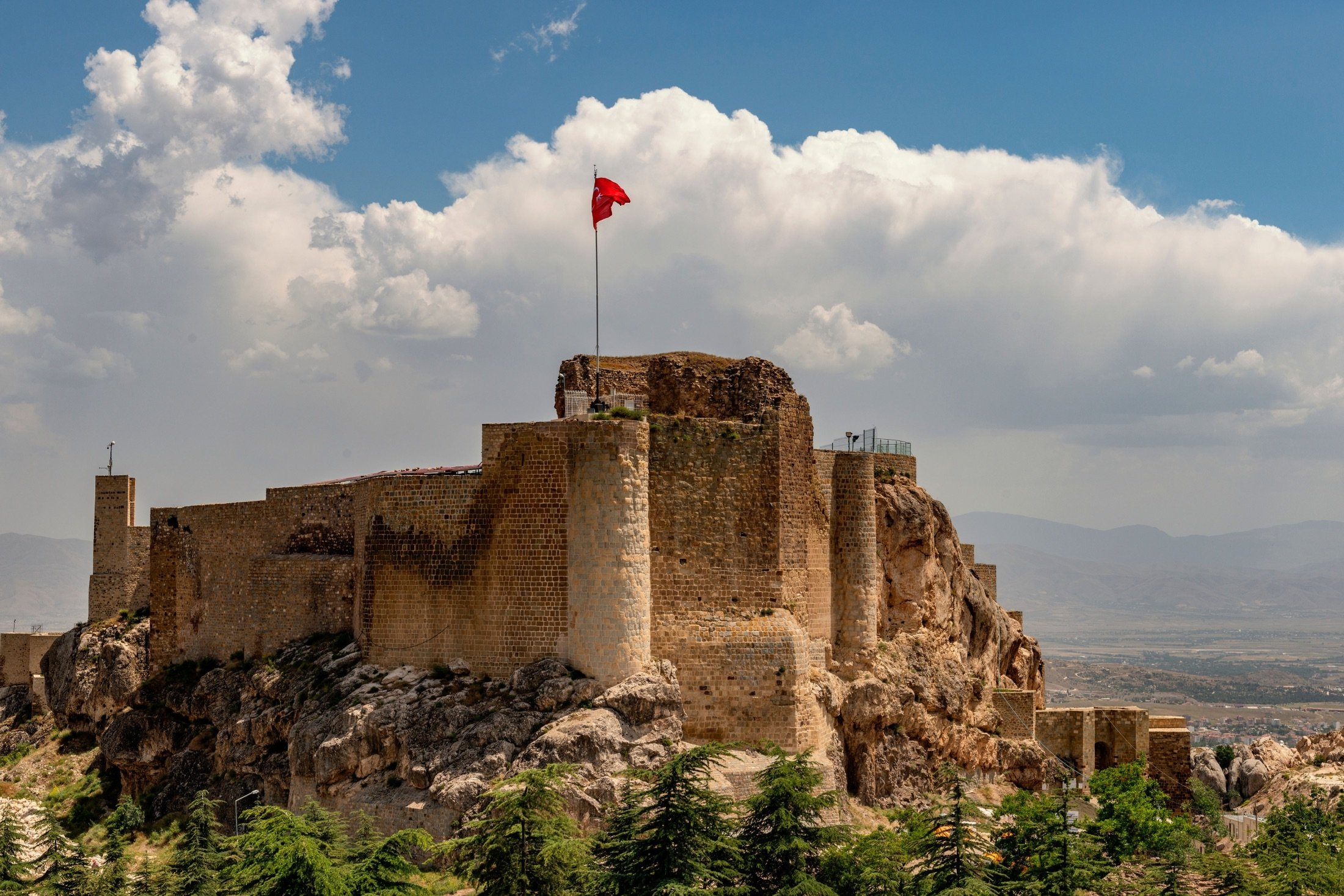 A Turkish flag waves on top of the Harput Castle, the nearly 2,000-year-old Urartian fortress, in Elazığ, Turkey. (Shutterstock Photo)
