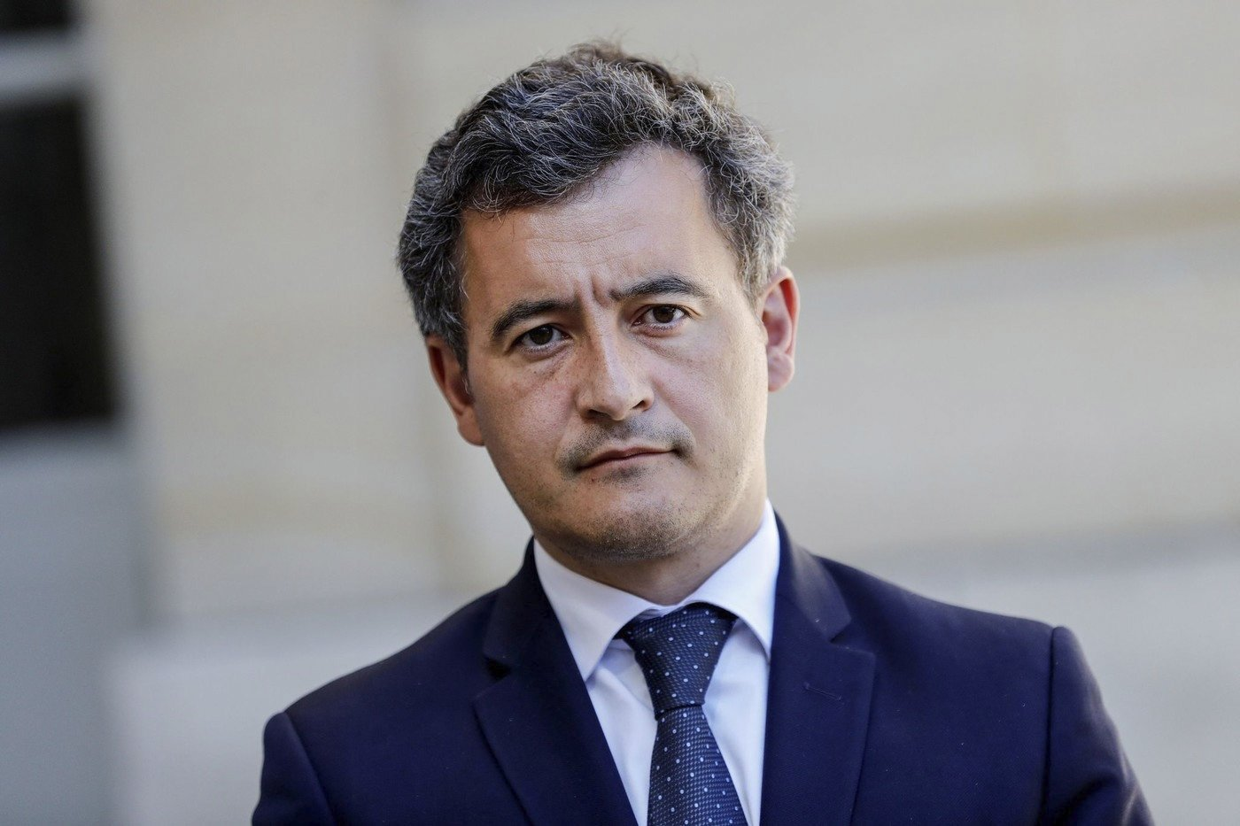 French Interior Minister Gerald Darmanin looks on as the French Prime Minister speaks to the press after a videoconference meeting on emergency measures regarding local authorities finances at the Hotel Matignon, Paris, France, May 29, 2020. (AFP Photo)