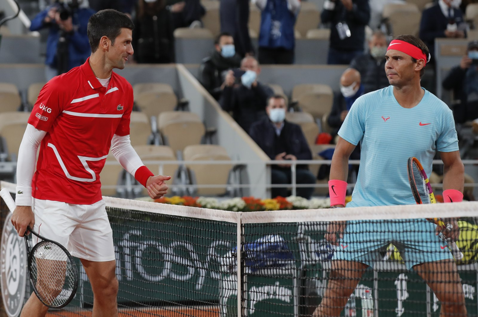 Novak Djokovic (L) and Rafael Nadal look at each other before the final match of the French Open tennis tournament at the Roland Garros stadium in Paris, France, Oct. 11, 2020. (AP Photo)