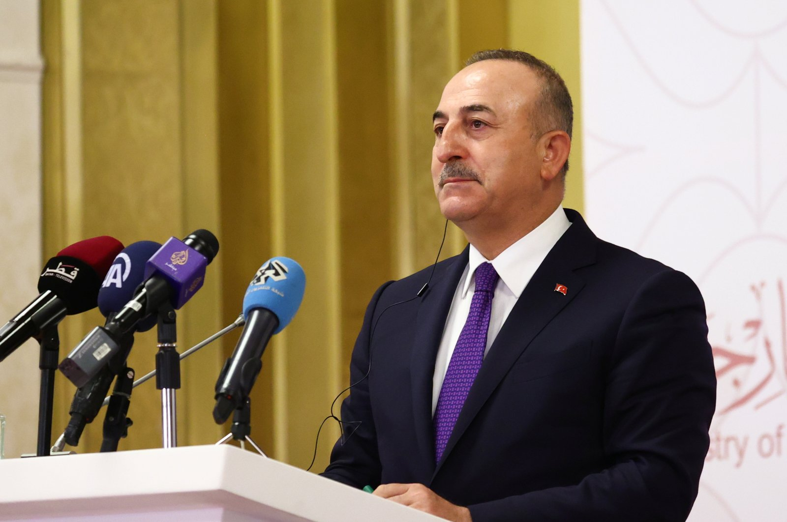 Foreign Minister Mevlüt Çavuşoğlu attends a news conference in Doha, Qatar, March 11, 2021. (REUTERS Photo)