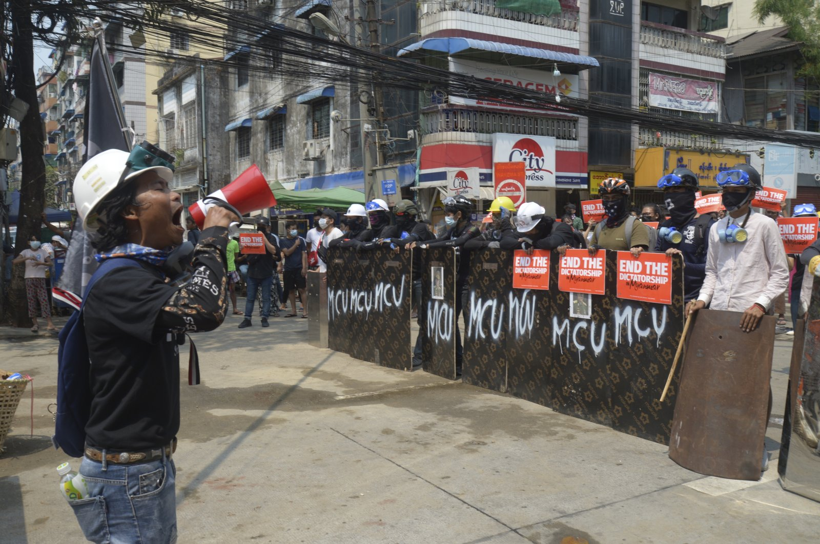 Anti-coup protesters gather with makeshift shields during a demonstration in Yangon, Myanmar, March 12, 2021. (AP Photo)