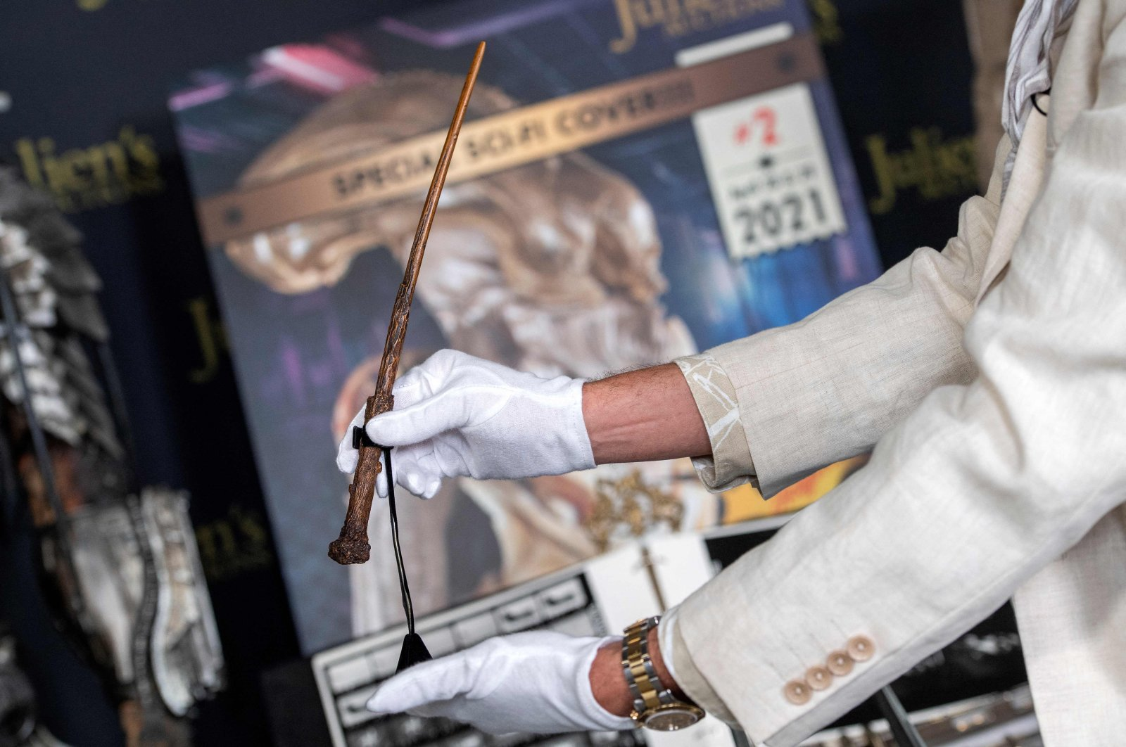 """An employee showcases Daniel Radcliffe's Harry Potter wand from """"Harry Potter and The Gobelet of Fire"""" at the preview of Julien's Auctions Hollywood Sci-Fi, Action Fantasy and More auction in Beverly Hills, California, March 10, 2021. (AFP Photo)"""