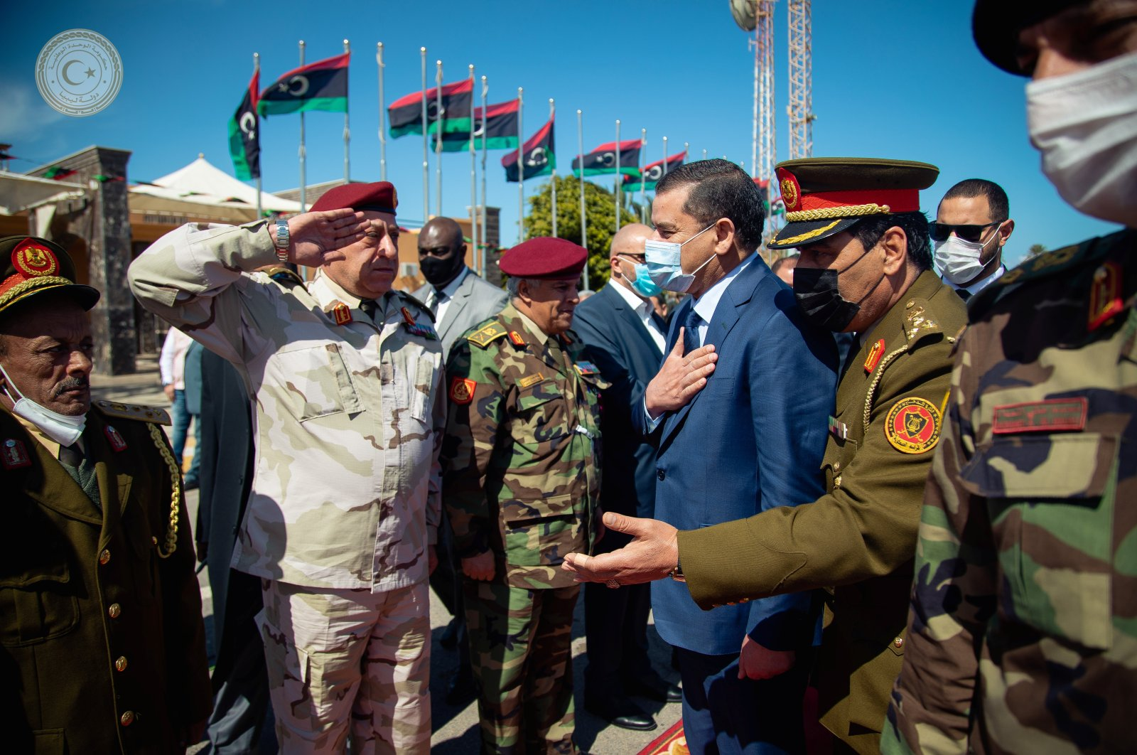 Libya's Prime Minister Abdul Hamid Dbeibeh is welcomed upon his arrival in Tripoli, Libya, March 11, 2021.  (REUTERS)