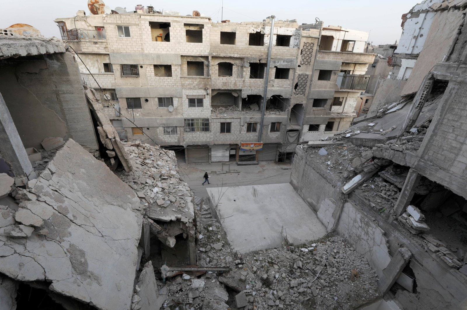 A man walks pasts damaged buildings in Douma, in the eastern suburbs of Damascus, Syria, March 9, 2021. (REUTERS Photo)