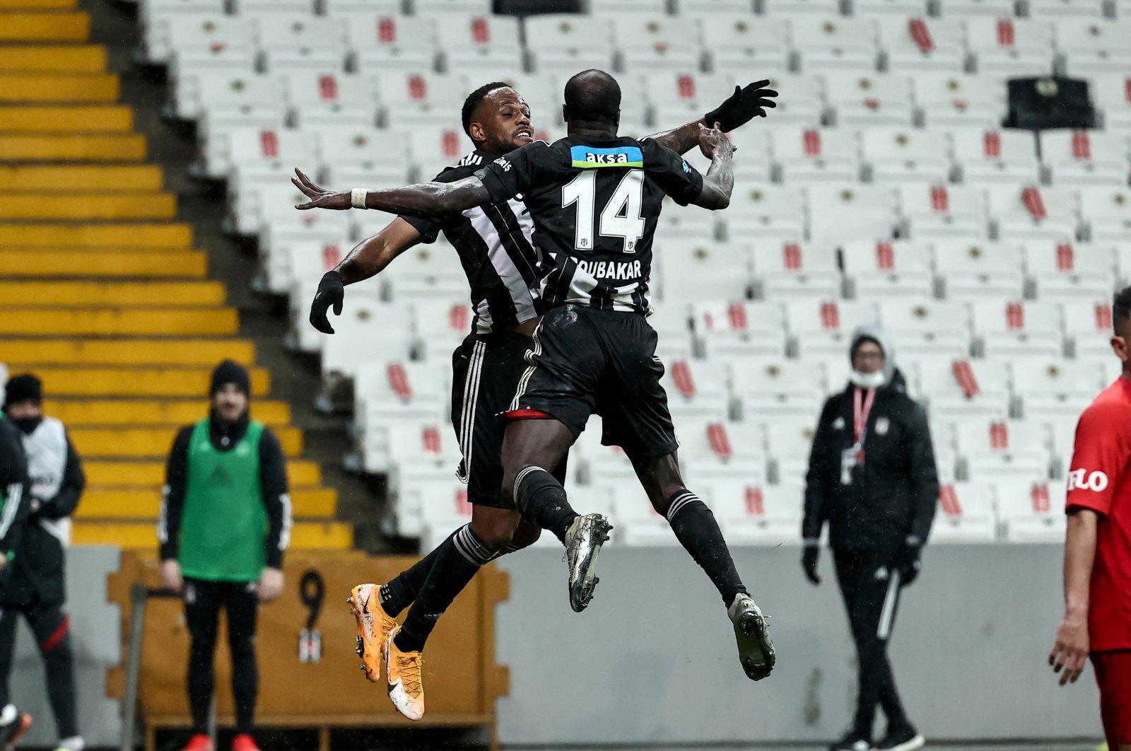 Beşiktaş' Cyle Larin (L) and Vincent Aboubakar celebrate a goal during a Süper Lig match against Gaziantep at Vodafone Park stadium, Istanbul, Turkey, March 11, 2021. (AA Photo)