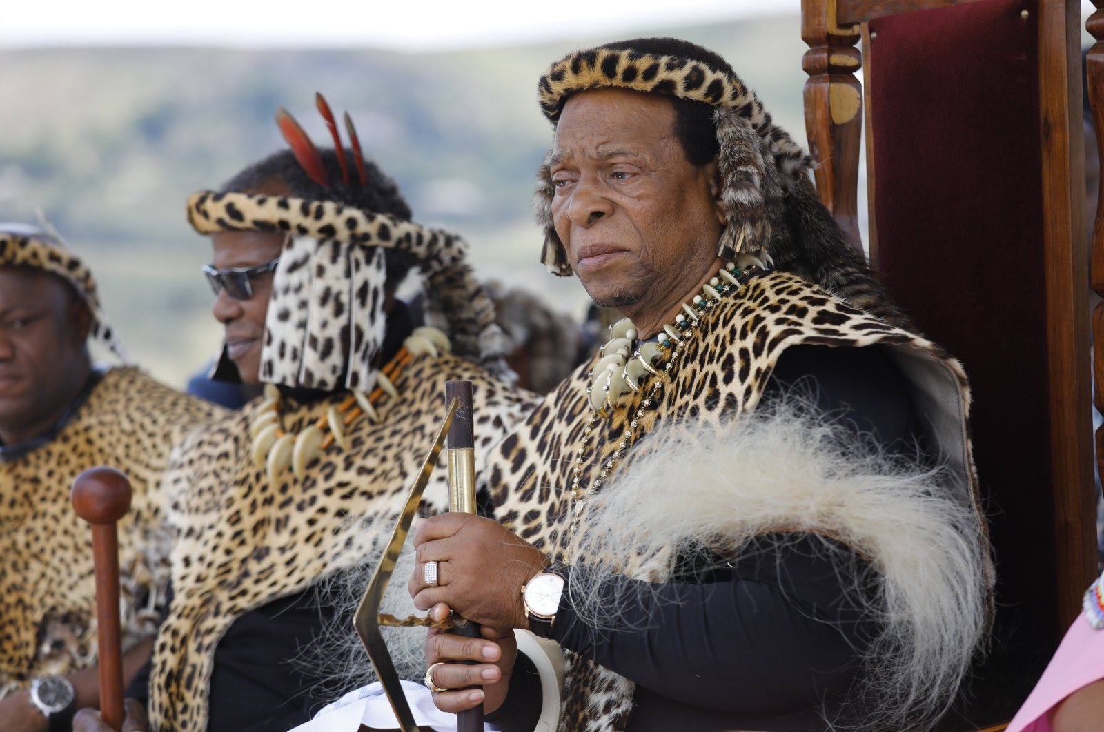 Zulu King Goodwill Zwelithini (R) watches members of a group perform as Zulu warriors and British Soldiers on the 140th-anniversary of the Battle of Isandluana in Dundee, South Africa, Jan. 25, 2019.