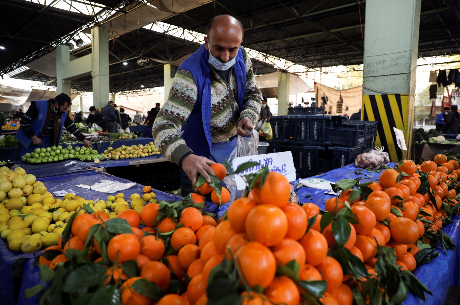A vendor wearing a protective mask arranges fruit on his stall at a local market, amid the coronavirus disease (COVID-19) outbreak in Ankara, Feb. 24, 2021. (Reuters Photo)