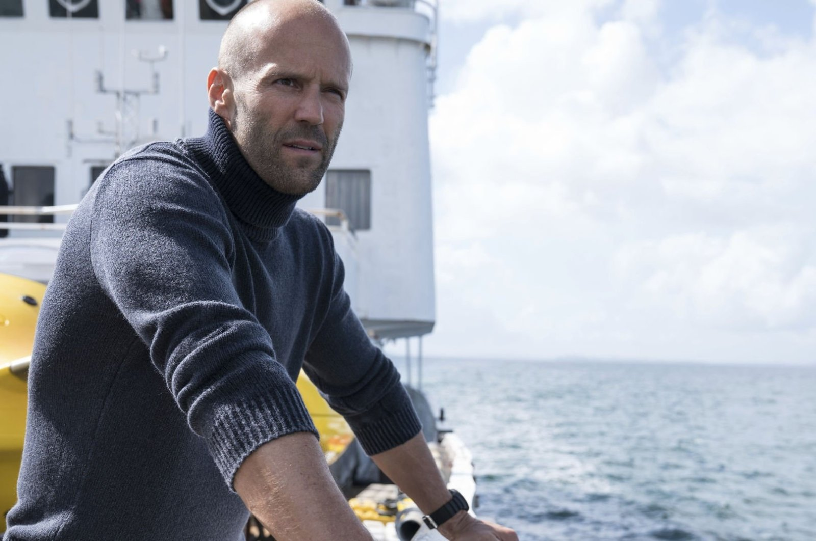 """Actor Jason Statham looks into the distance in a scene from the 2018 action flick """"The Meg."""" (Archive Photo)"""