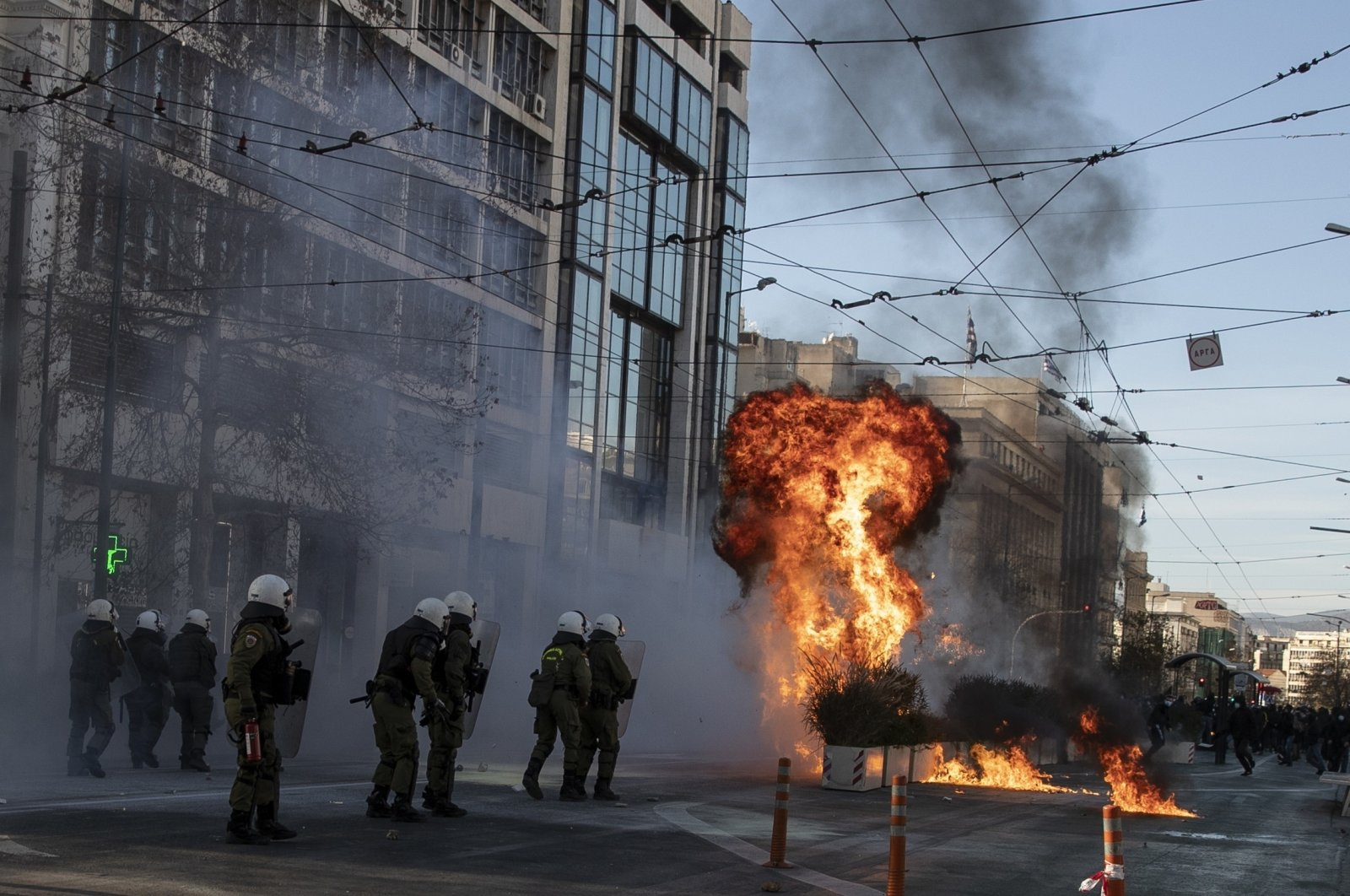 Protesters throw a petrol bomb at riot police during a student rally against campus policing, in Athens, Greece, Feb. 10, 2021. (AP Photo)