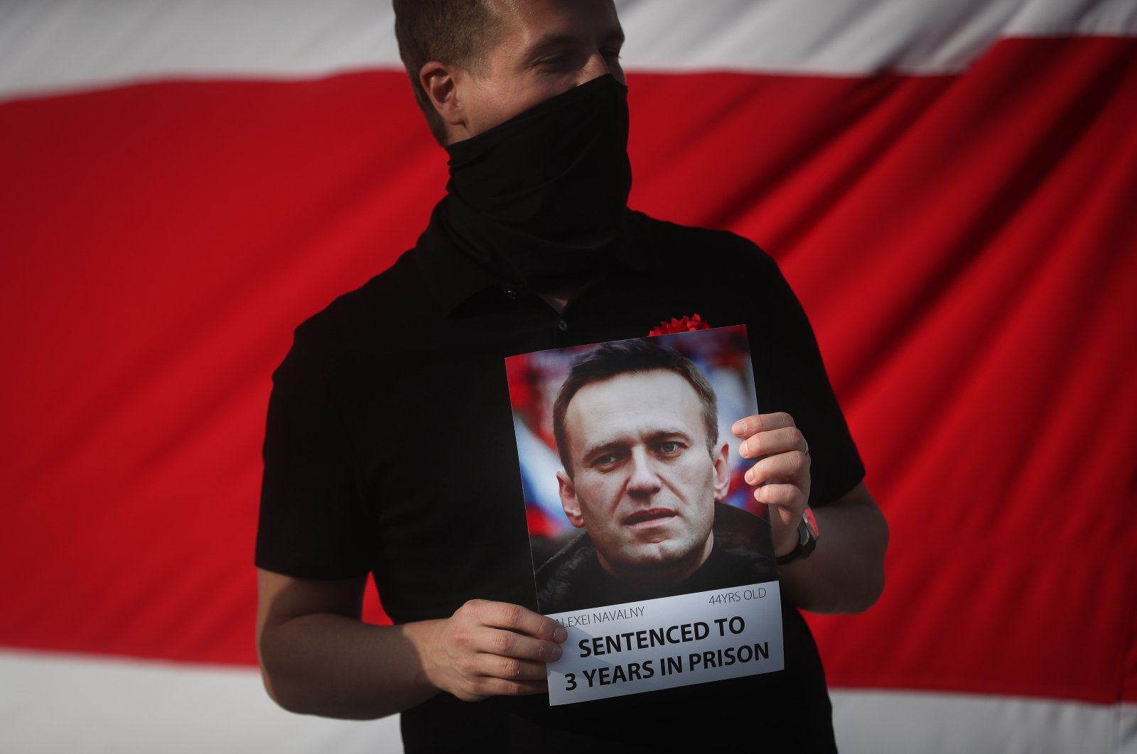 A man holds a picture of the Russian opposition leader Alexei Navalny in a demonstration in solidarity with Belarus' political prisoners, during the visit of Svetlana Tikhanovskaya in Lisbon, Portugal, March 6, 2021. (EPA Photo)