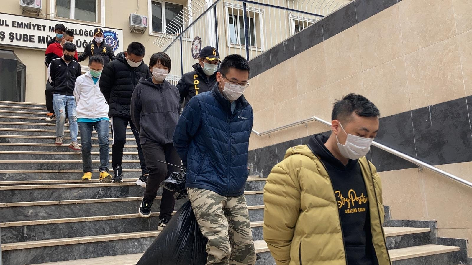 Turkish Police escort suspected gang members in Istanbul on Saturday, March 13, 2021 (DHA Photo)