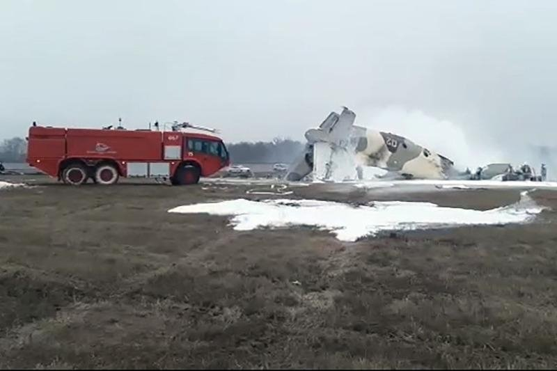 A firetruck extinguishes the fire on the wreckage of the crashed military plane in Kazakhstan on Saturday, March 13, 2021 (AA Photo)