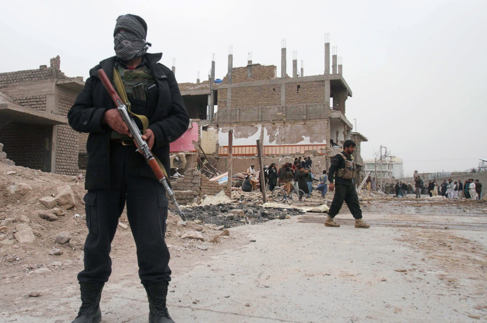 Police officers inspect the site after a car bomb blast in Herat province, Afghanistan, March 13, 2021. (Reuters Photo)