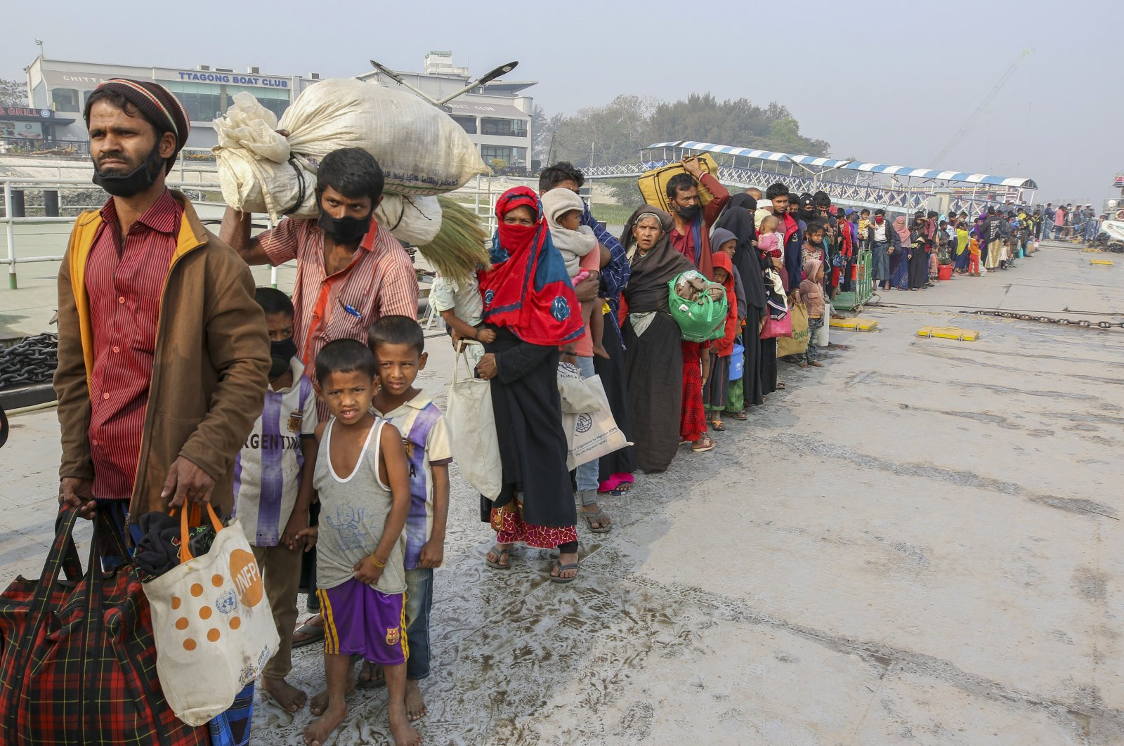Rohingya refugees headed to the Bhasan Char island prepare to board navy vessels from the south eastern port city of Chattogram, Bangladesh, Feb. 15, 2021. (AP Photo)