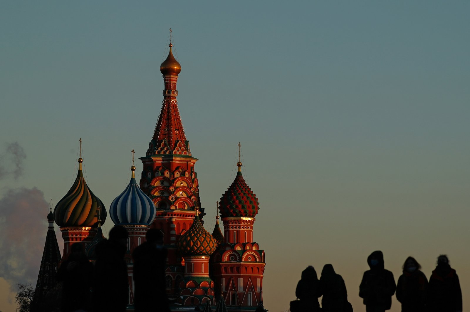 People walk along Red Square in front of St. Basil's Cathedral in Moscow, Russia March 11, 2021. (Reuters Photo)