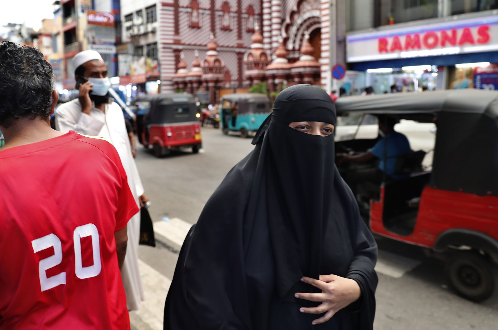 A burqa-clad Sri Lankan Muslim woman walks on the street of Colombo, Sri Lanka, Saturday, March 13, 2021. (AP Photo)
