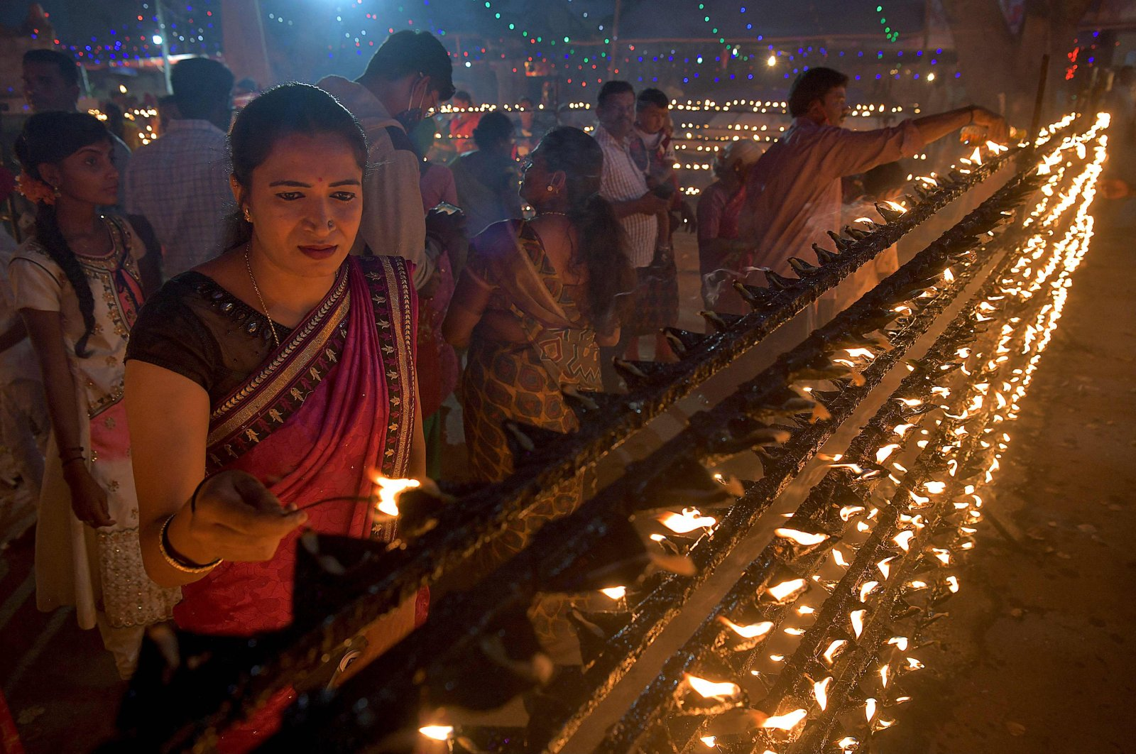 Hindu devotees light oil lamps during Lakshadeepotsava, the festival of a hundred thousand lamps, during the Shivarathri festival at the Basavanna Temple on the outskirts of Bangalore on March 11, 2021.(AFP Photo)