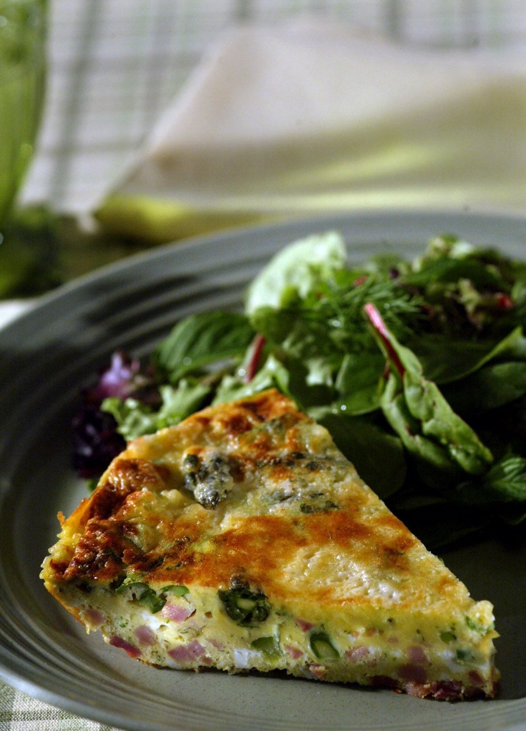 Greens, feta cheese and ham make a filling and delicious frittata. (Getty Images)