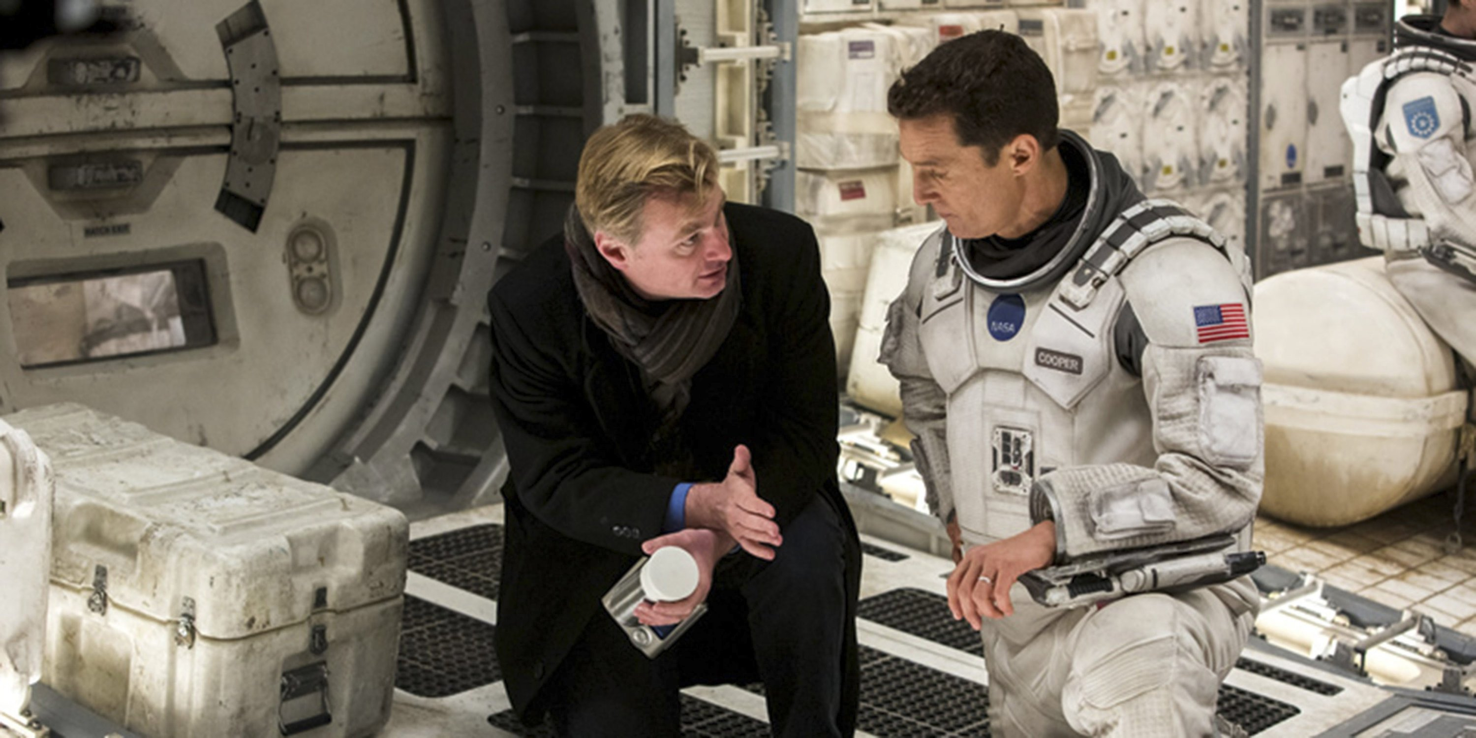 Christopher Nolan speaks with Matthew McConaughey during the filming of 'Interstellar'.