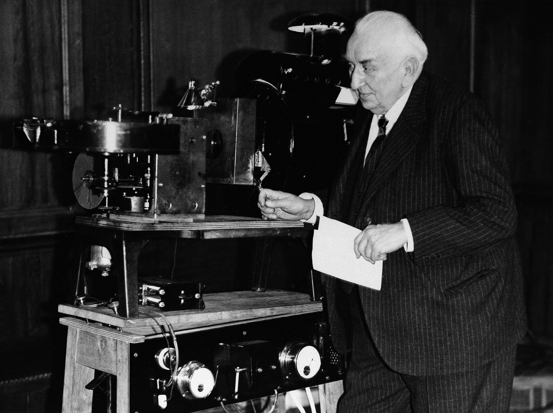 Louis Lumiere who made his first film in February 25, 1935 shows a new invention of his by which he projected a stereoscopic image on the screen, March 6, 1935. Location unknown. (AP Photo)
