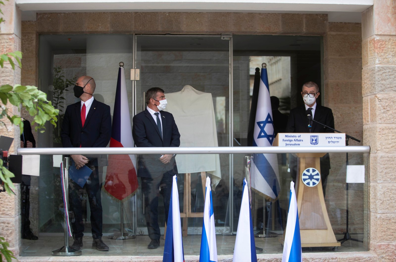 Czech Prime Minister Andrej Babis, Israeli Foreign Minister Gabi Ashkenazi and Israeli Public Security Minister Amir Ohana attend an inauguration ceremony of a Czech diplomatic representation in Jerusalem March 11, 2021. (REUTERS)