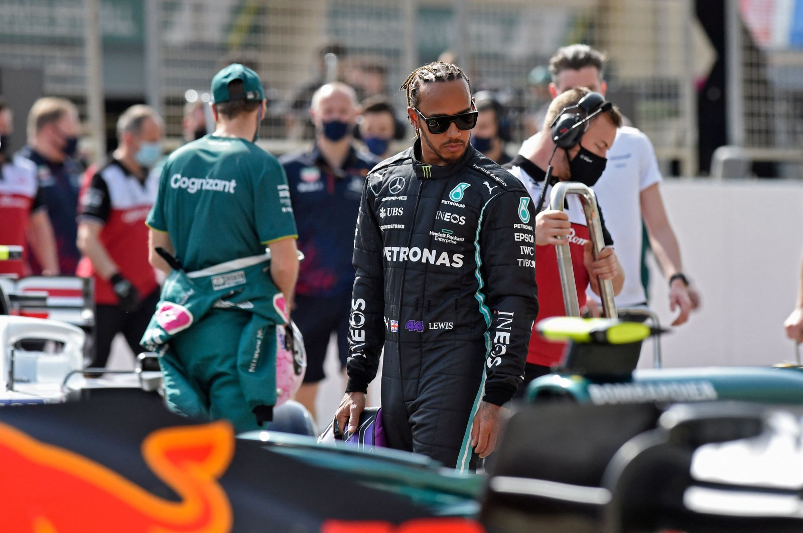Mercedes' British driver Lewis Hamilton (C) looks on during the first day of the Formula One pre-season testing at the Bahrain International Circuit, Sakhir, Bahrain, March 12, 2021. (AFP Photo)