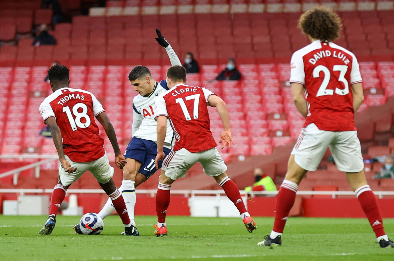 Tottenham Hotspur's Erik Lamela scores his team's first goal with a sumptuous Rabona flick,in a match they ended up losing 2-1at the Emirates Stadium against bitter rivals Arsenal,London, U.K., March 14, 2021. (Reuters Photo)