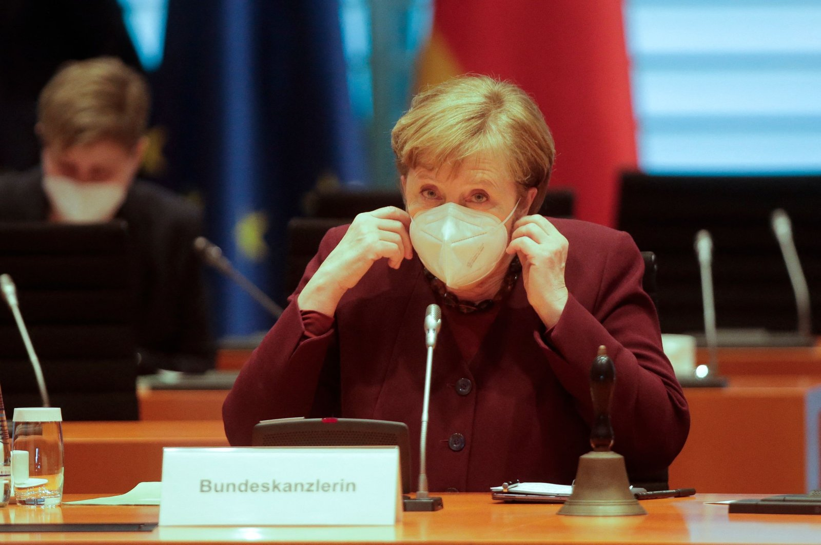 German Chancellor Angela Merkel wears a mask as she arrives for the weekly Cabinet meeting at the Chancellery in Berlin, March 10, 2021. (AFP Photo)