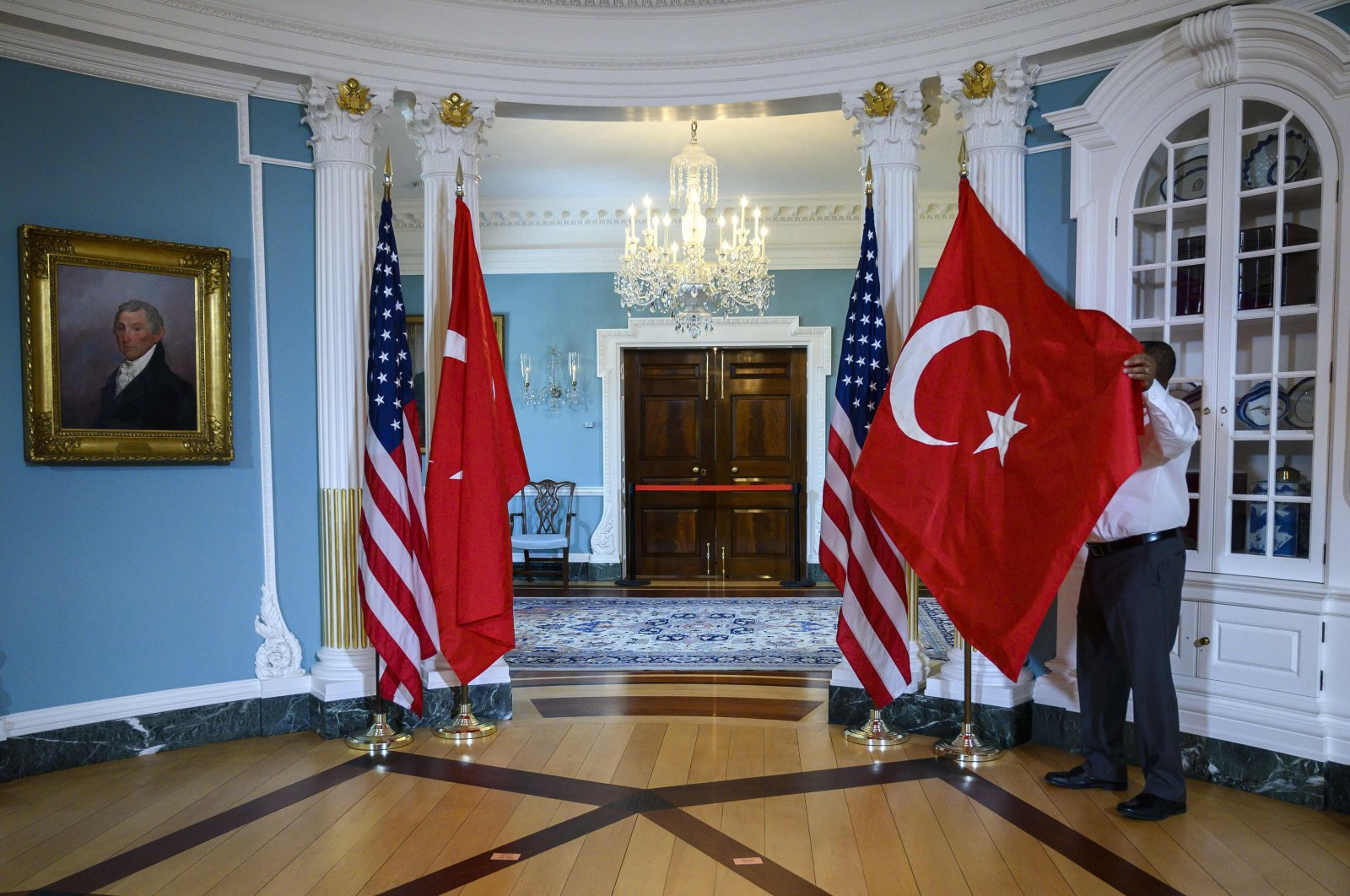 A State Department staffer adjusts the flags of Turkey and the U.S. before a bilateral meeting, Washington D.C., U.S., April 3, 2019. (Photo by Getty Images)