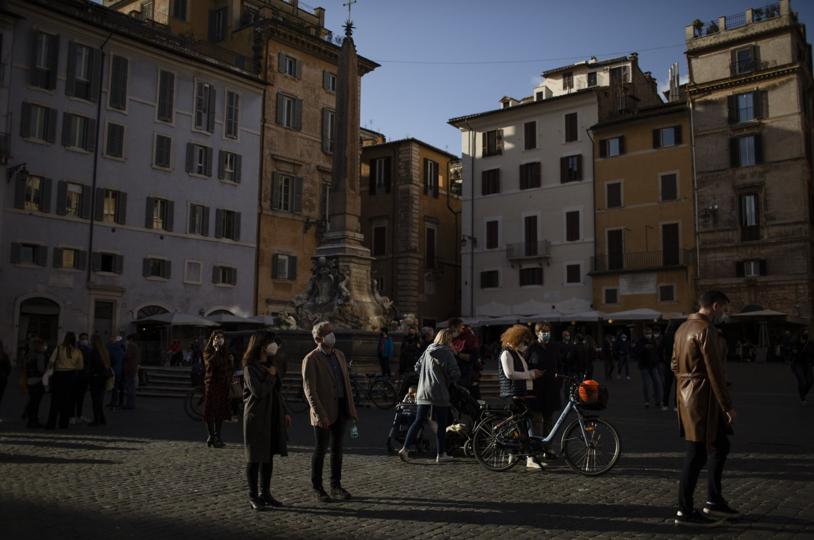 People spend their time outdoors amid the coronavirus spread, central Rome, Italy, March 13, 2021. (Photo by Getty Images)