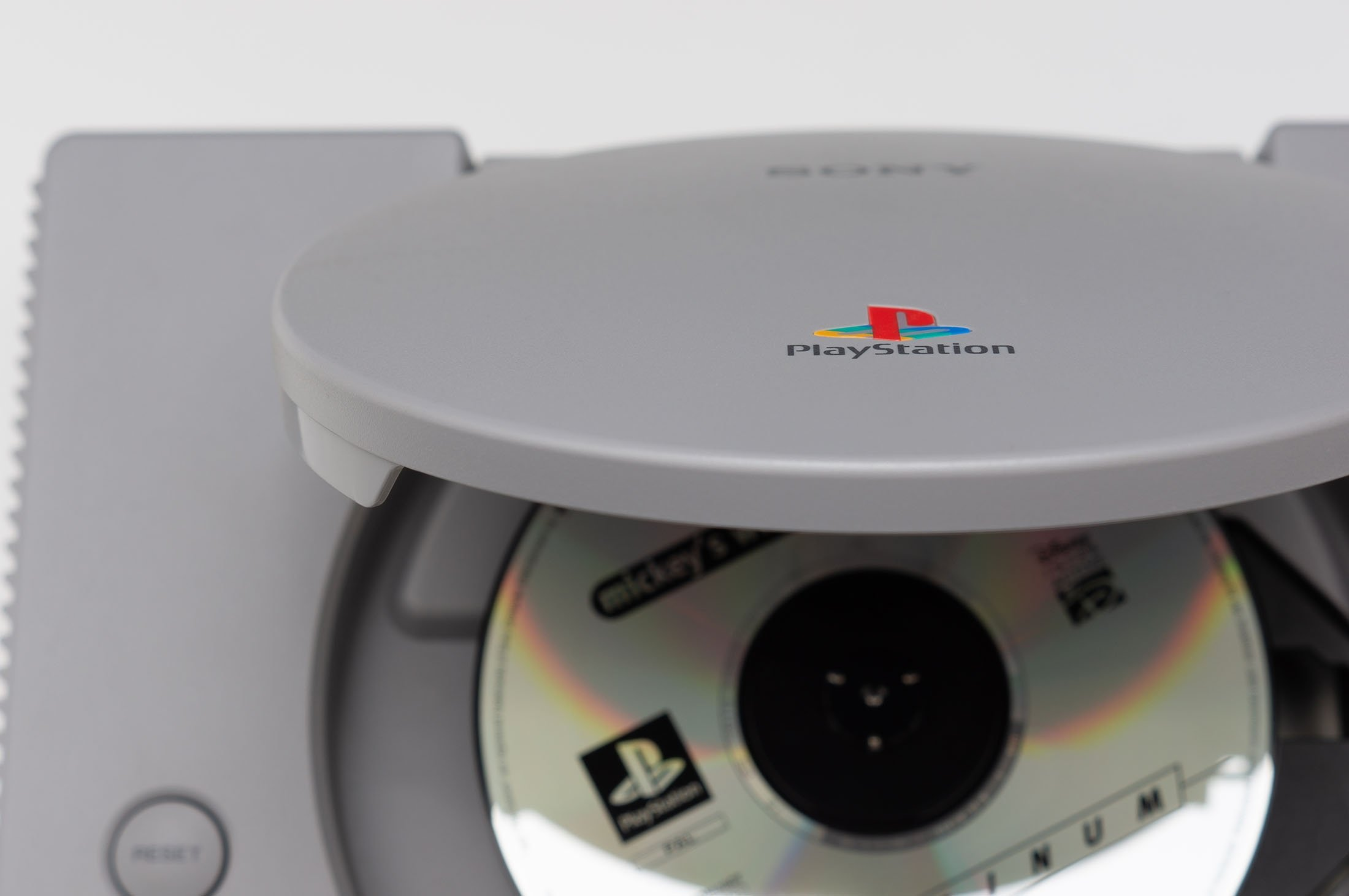 A game disk sits in Sony's original PlayStation console in Melbourne, Australia, July 23, 2018. (Shutterstock Photo)