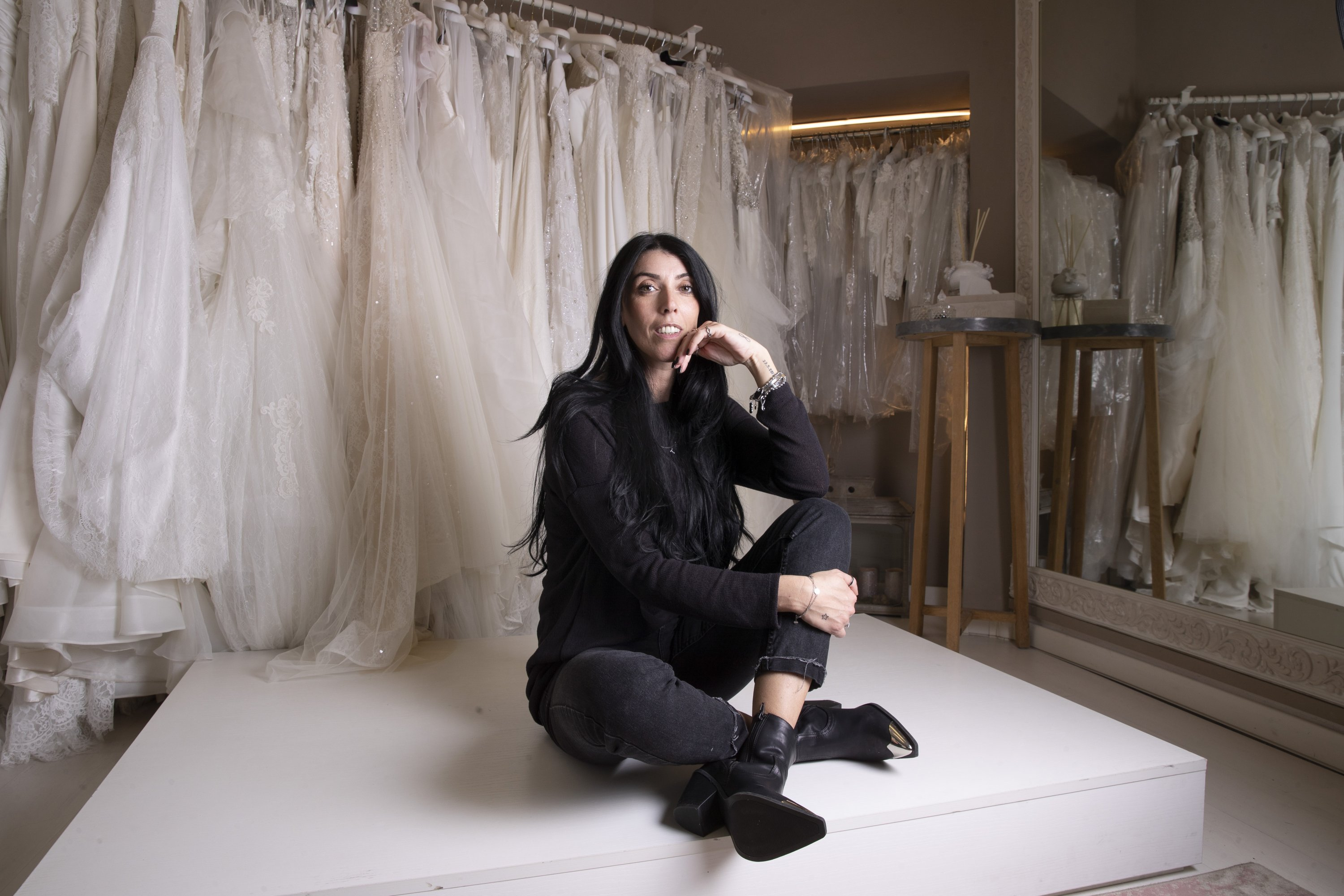 Anita Galafate poses in a wedding dress shop in Rome, Italy, March 9, 2021. (AP Photo)