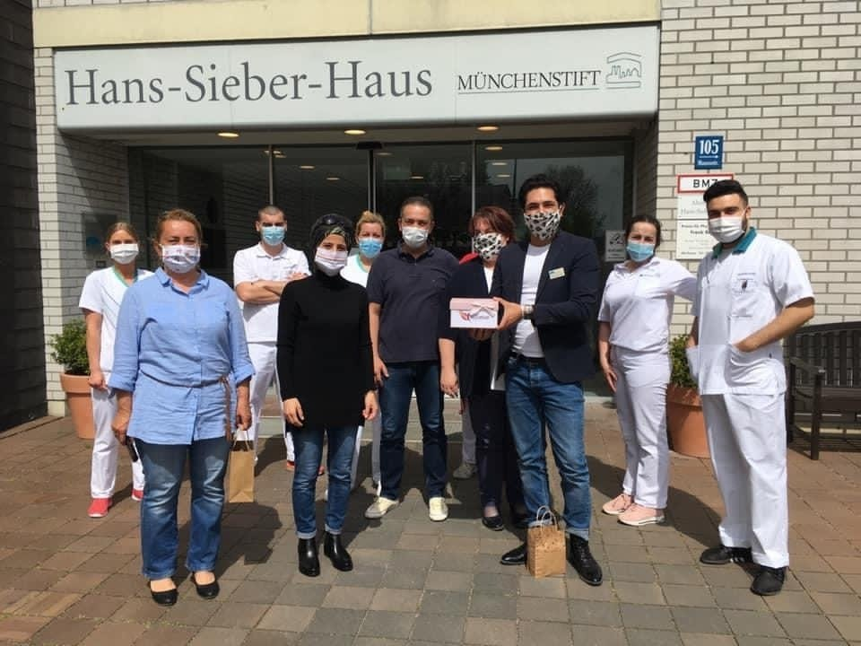 UID members, including Nevin Tekin (2nd L), deliver face masks to a nursing home in Munich, Germany. (Photo Courtesy of UID)