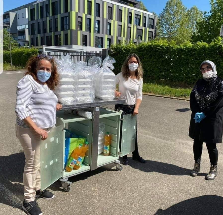 Women pose with the food they prepared to deliver to the needy in France. (Photo Courtesy of UID)