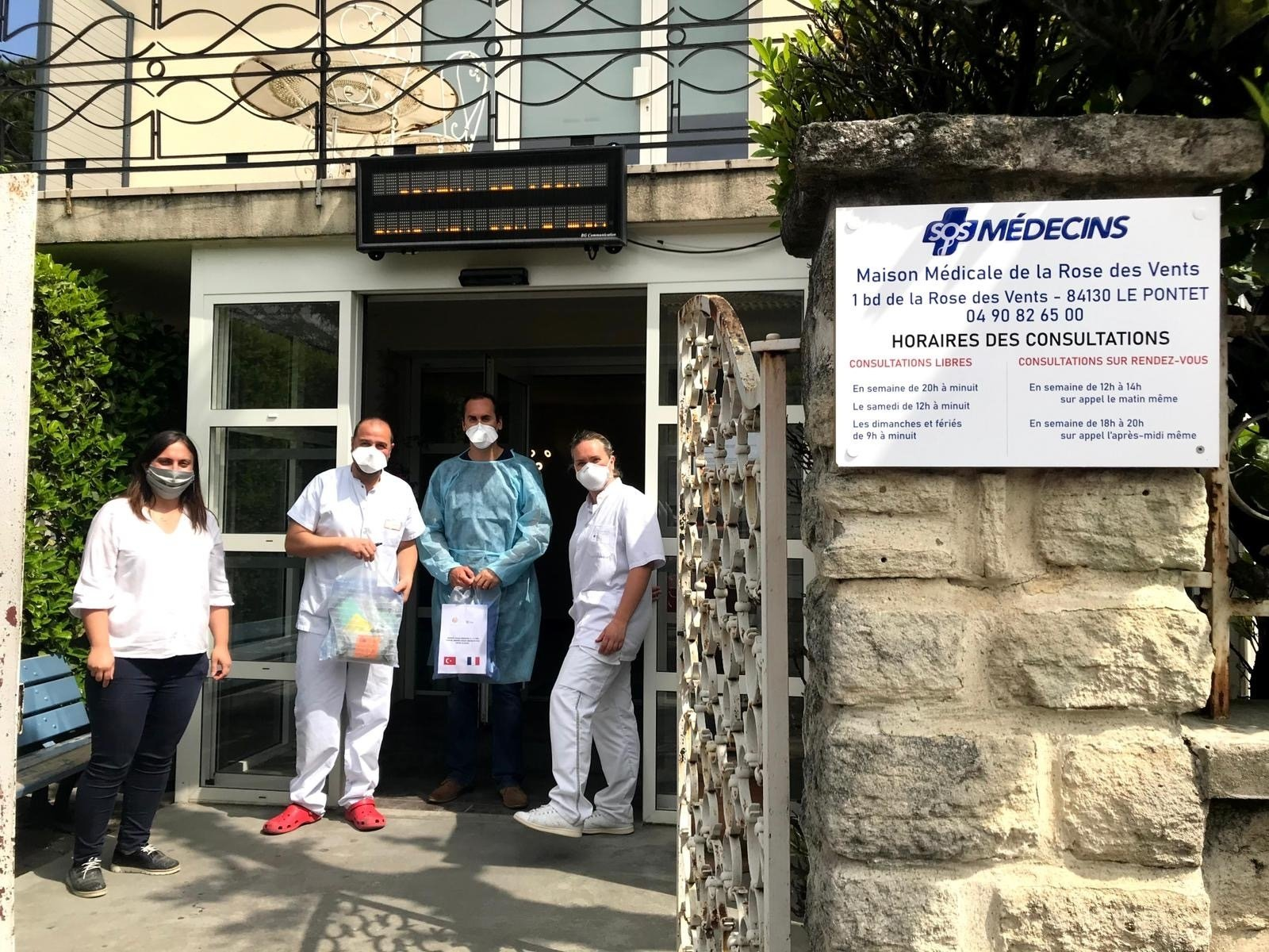 Women deliver the masks they produced to a clinic in France. (Photo Courtesy of UID)