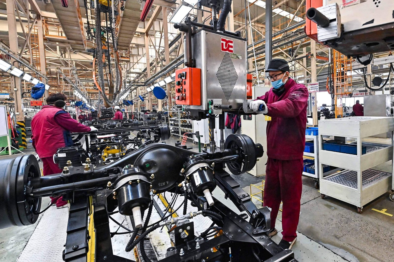 Employees work on a truck assembly line at a Jianghuai Automobile Group Corp. (JAC) factory in Qingzhou in Shandong province, eastern China, March 15, 2021. (AFP Photo)