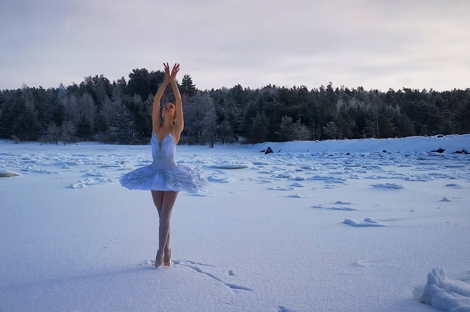 Ilmira Bagautdinova, a ballet dancer from Mariinsky Theater, performs on the ice of frozen Batareynaya Bay to protest the construction of a grain terminal and other infrastructure in the Gulf of Finland, in the Leningrad region, Russia, in this still image taken from video released on Feb. 20, 2021. (Reuters Photo)