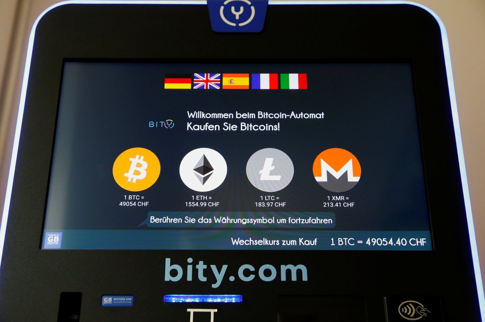 The exchange rates and logos of Bitcoin (BTH), Ether (ETH), Litecoin (LTC) and Monero (XMR) are seen on the display of a cryptocurrency ATM in Zurich, Switzerland, March 4, 2021. (Reuters Photo)