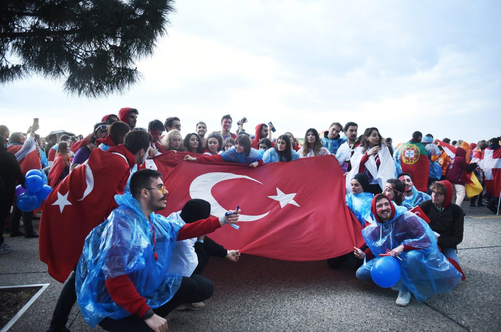 Turkish Erasmus students hold a Turkish flag during an annual Erasmus student meeting, in Thessaloniki, Greece, April 18, 2019. (Shutterstock Photo)